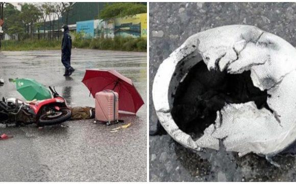 Hiện trường vụ việc, chiếc mũ bảo hiểm của nạn nhân bị thủng, cháy sém biến dạng (ảnh chụp màn hình trên báo Dân Việt).